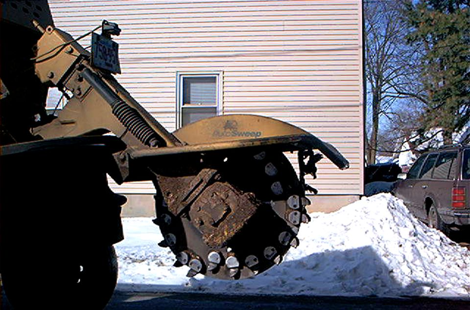 Stump grinders (image) are great when you can afford them. They save you time and energy.