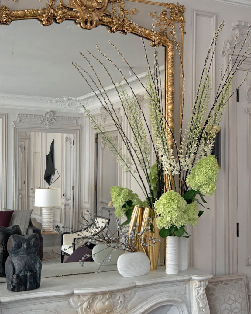 Mantle with gold mirror and flowers