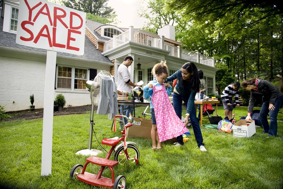Wide view of suburban yard sale