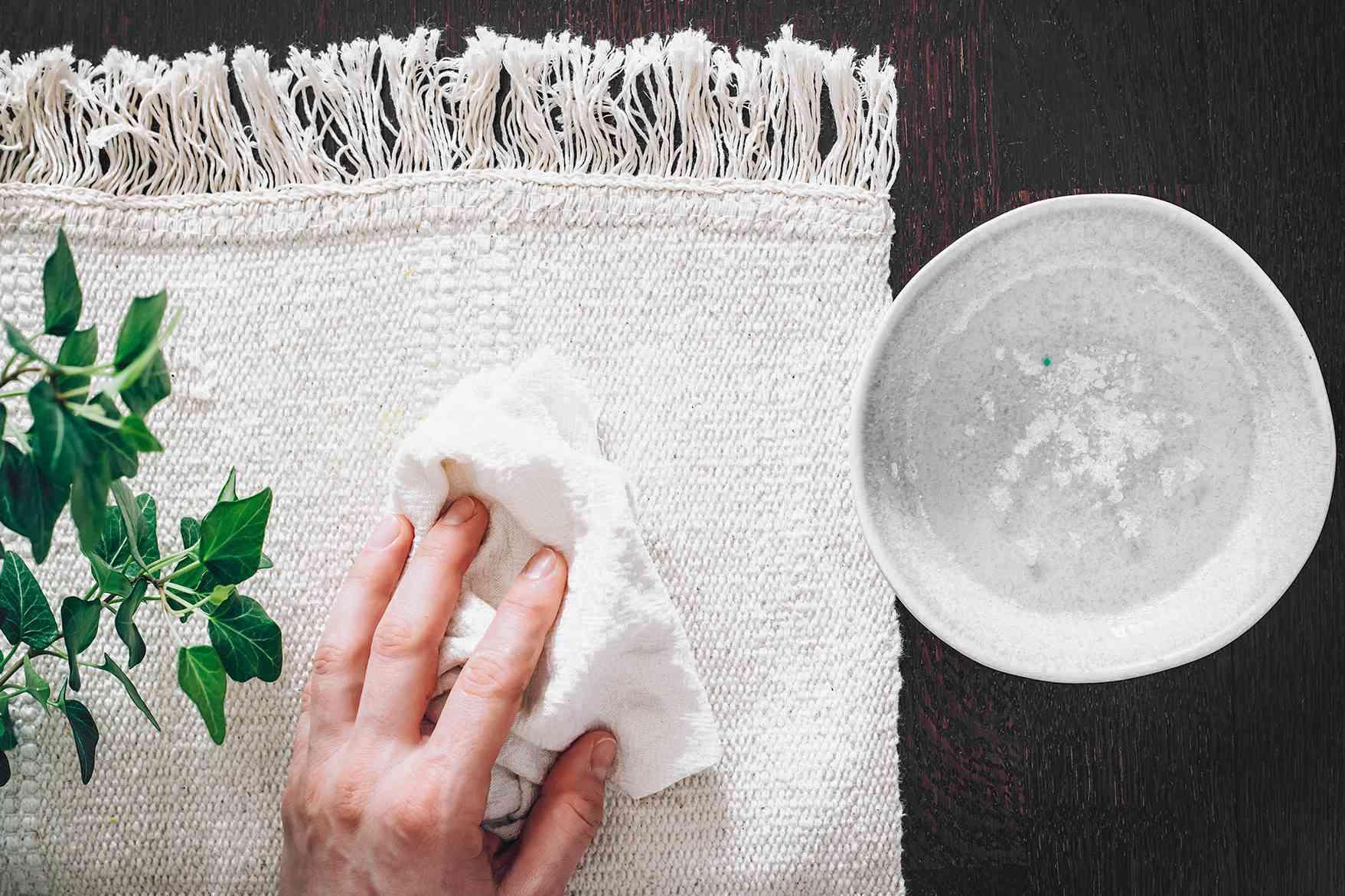 person using bleach on a rug