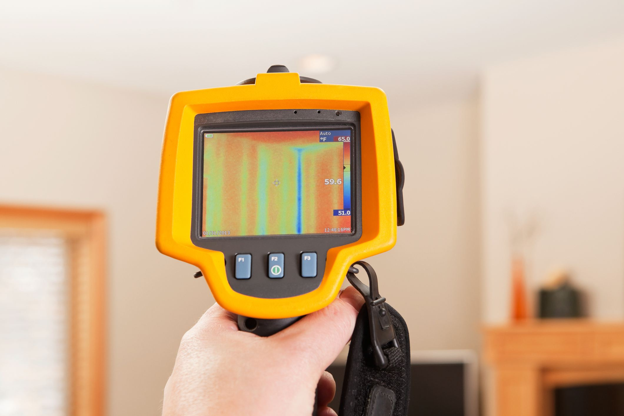 Infrared thermal imaging camera pointing to house