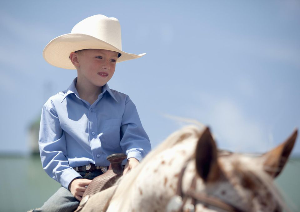 Five-year-old boy on a horse at a show