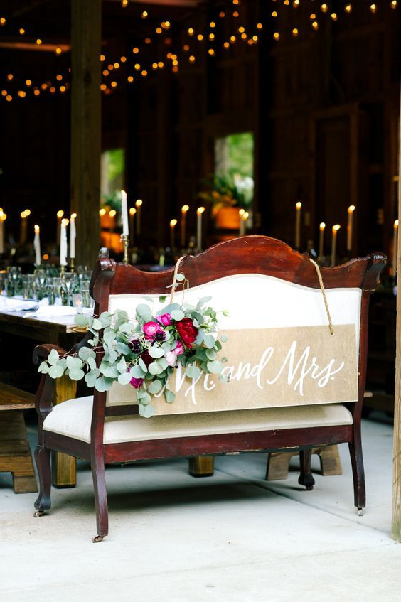 a bench at a barn wedding