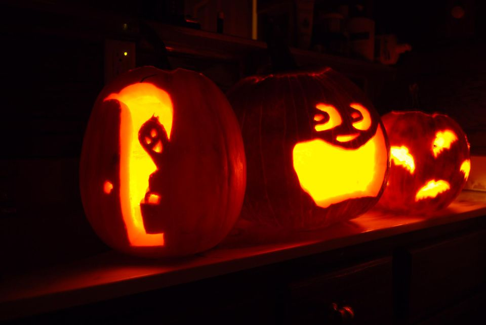 A line of artistically cut jack-o-lanterns