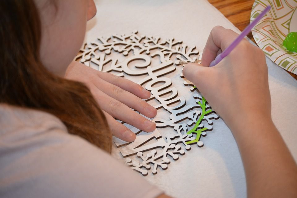 Girl making party craft
