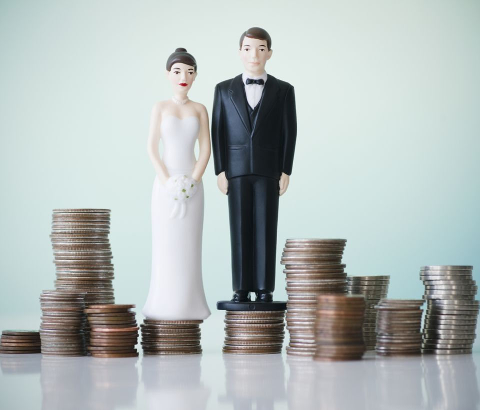 wedding figures stood on top of coins