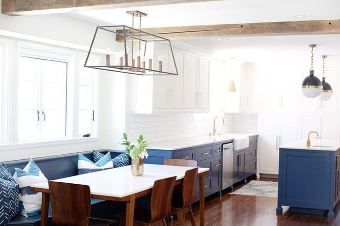 blue and white kitchen with wood floors