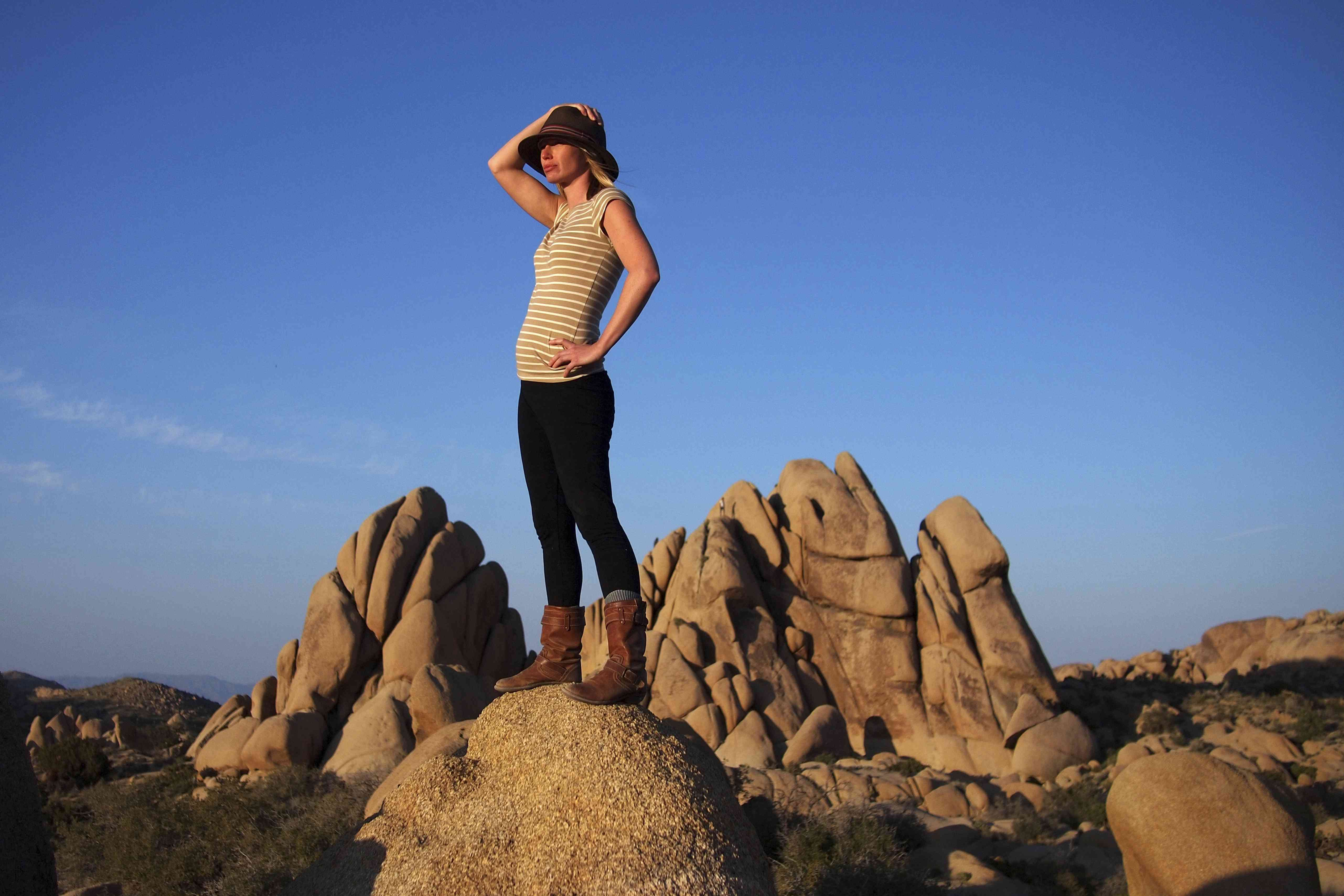 woman watches the sunset in Joshua Tree National Park