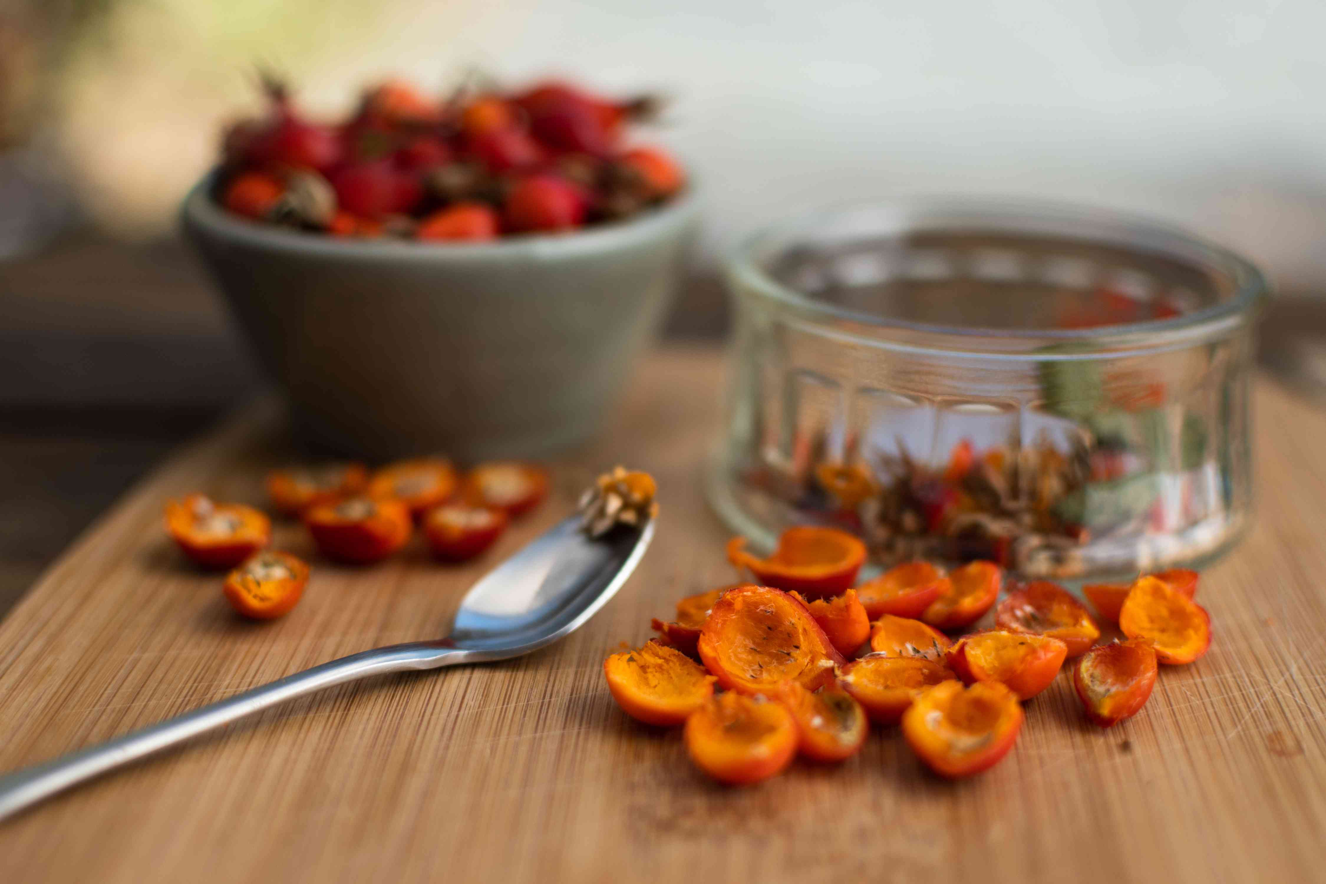 Seeds removed with spoon from inside harvested rose hips