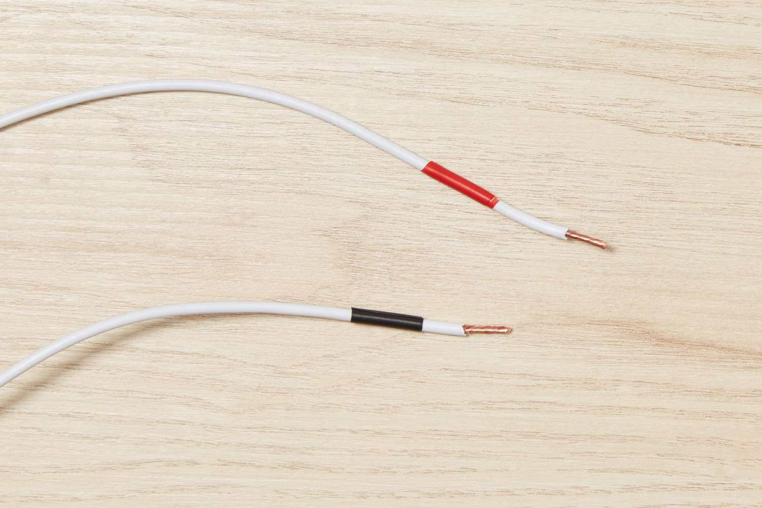 White electrical wire with red and black tape