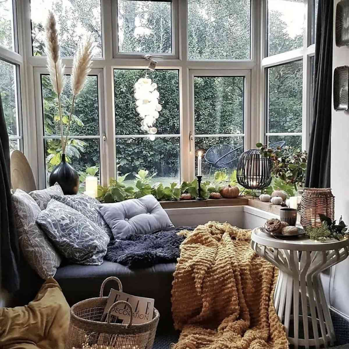 nook created in corner with view and small pumpkins on windowsill