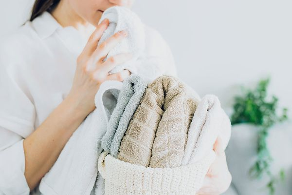 person smelling towels