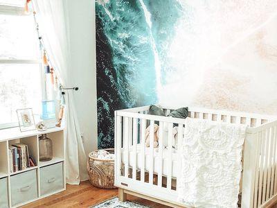 Boho-inspired beach-themed nursery with graphic ocean mural