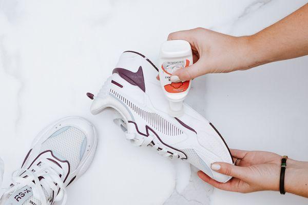 Someone polishing athletic shoes