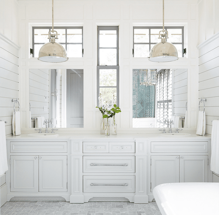 Grey and white bathroom with pendant lights and white vanity.