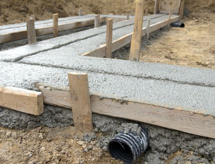 Drainage tile under poured cement footing.