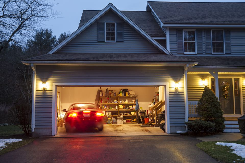 An open car garage with a car