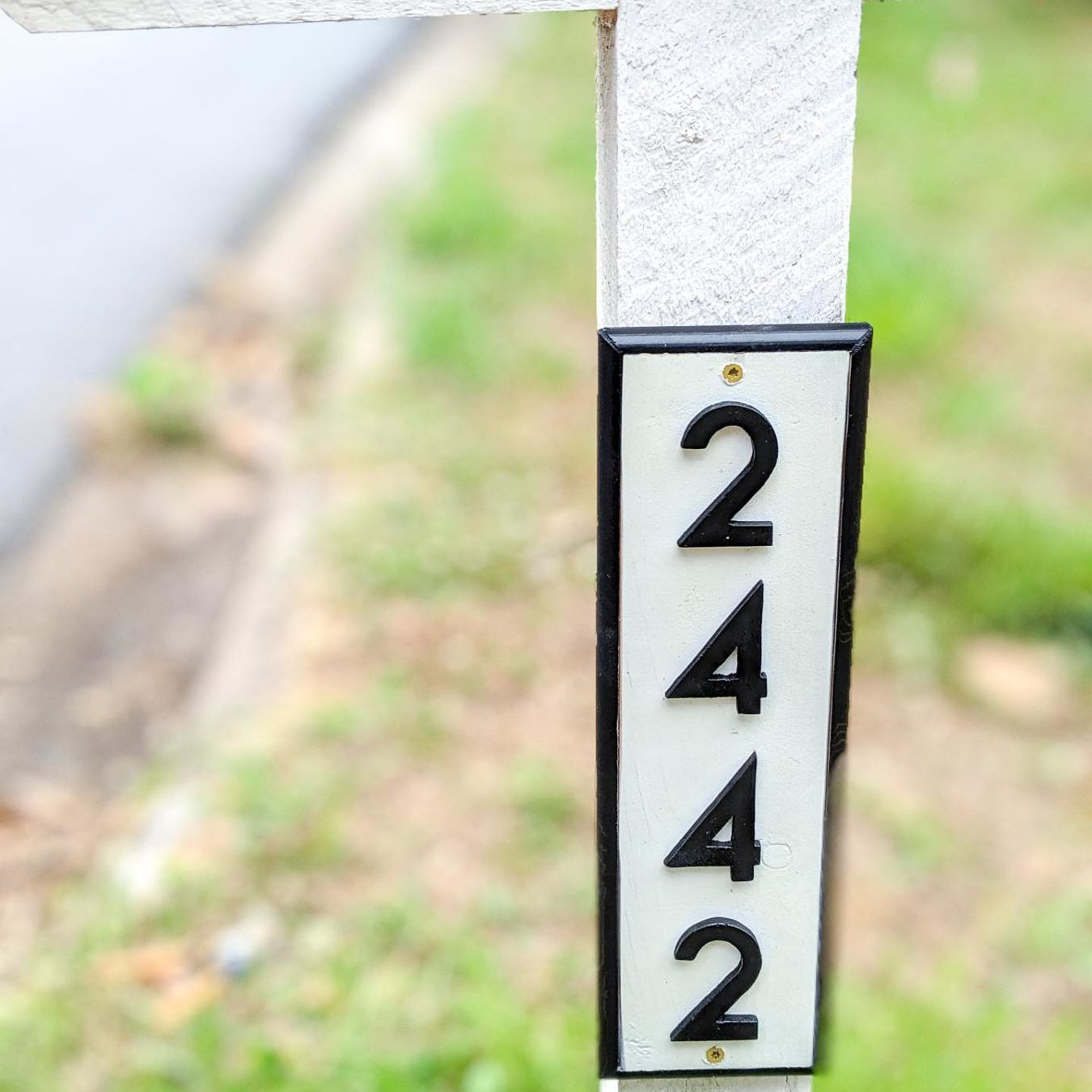 House numbers printed on a mailbox post.