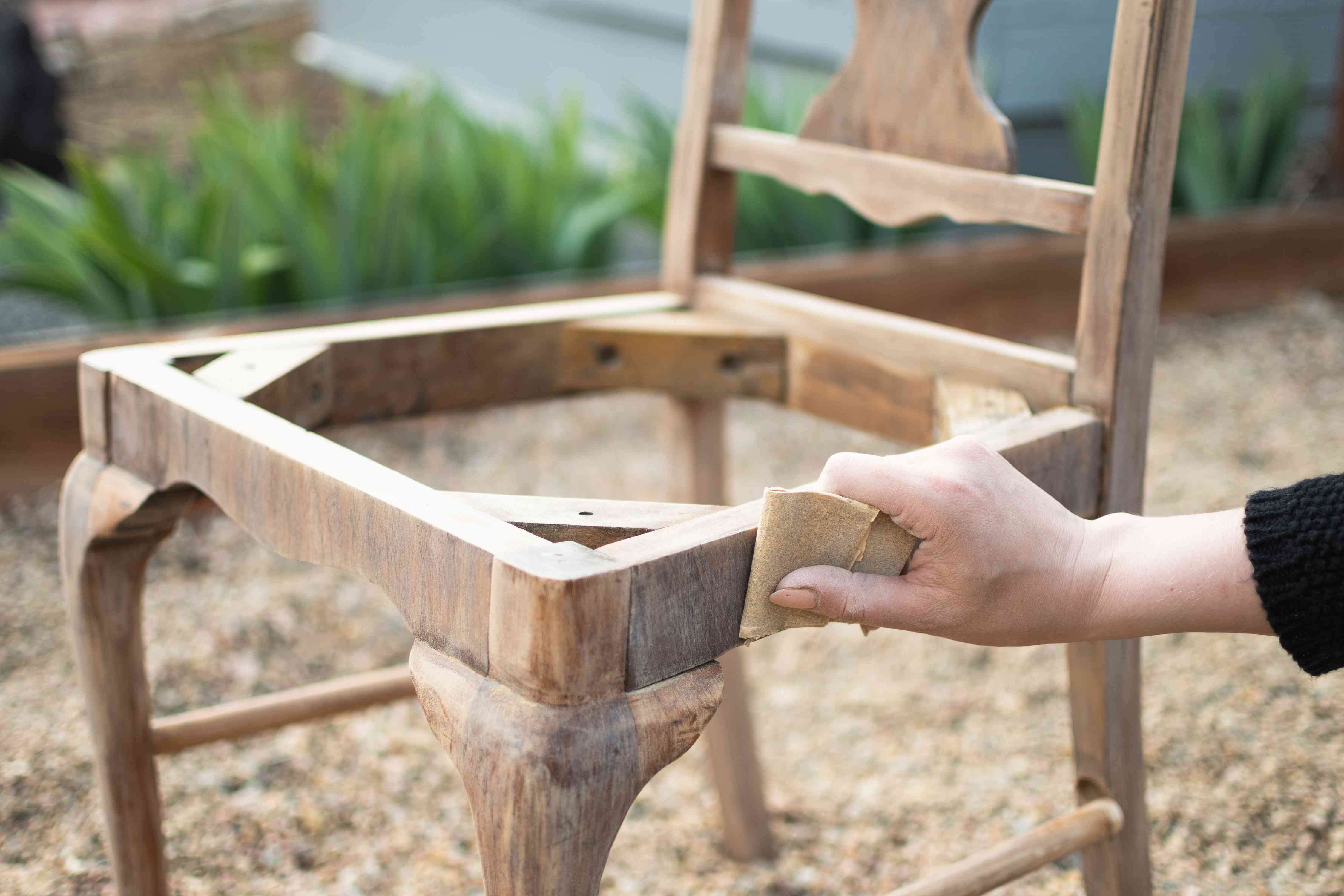 Wooden chair sanded down with sandpaper