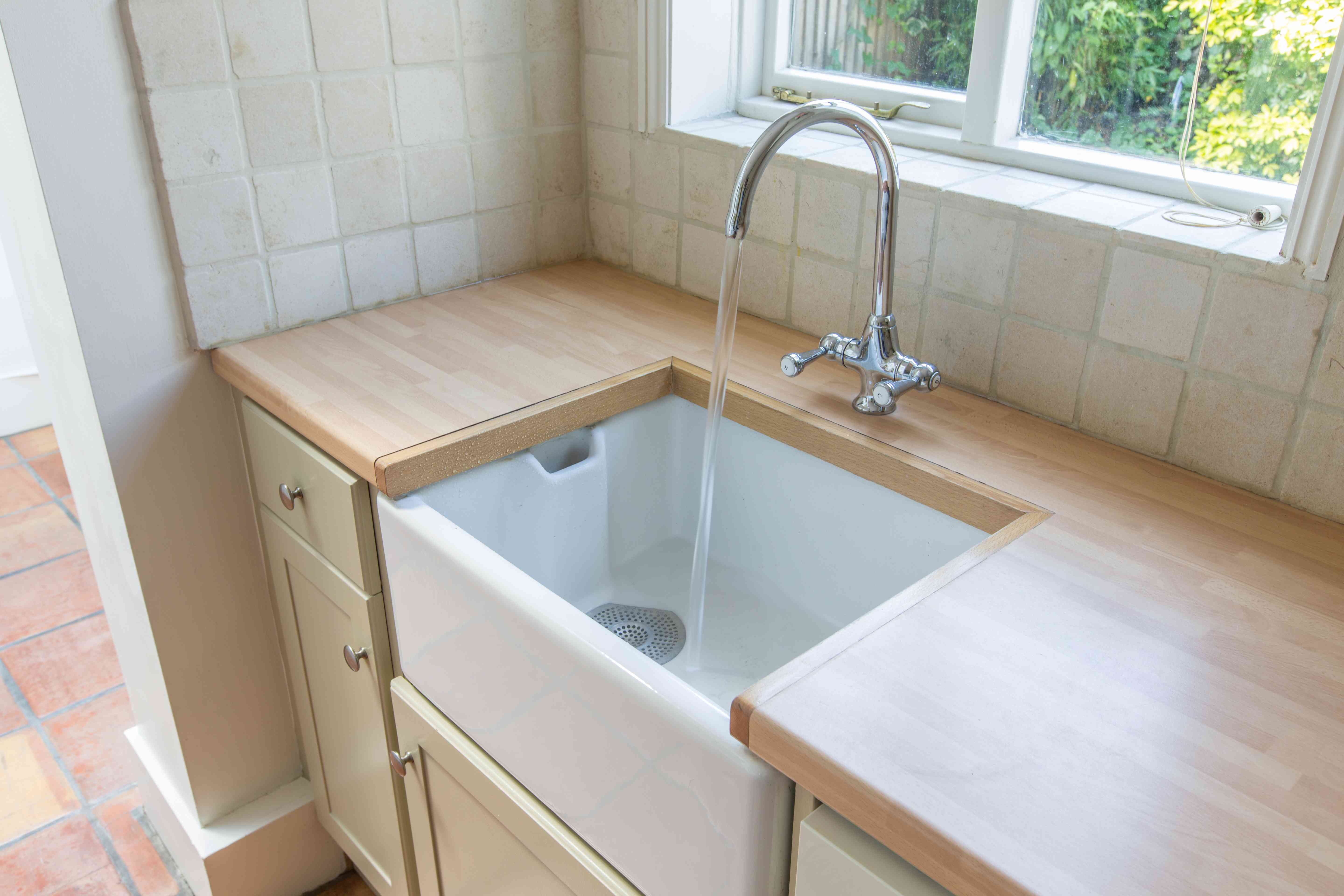 white kitchen sink and wood countertop