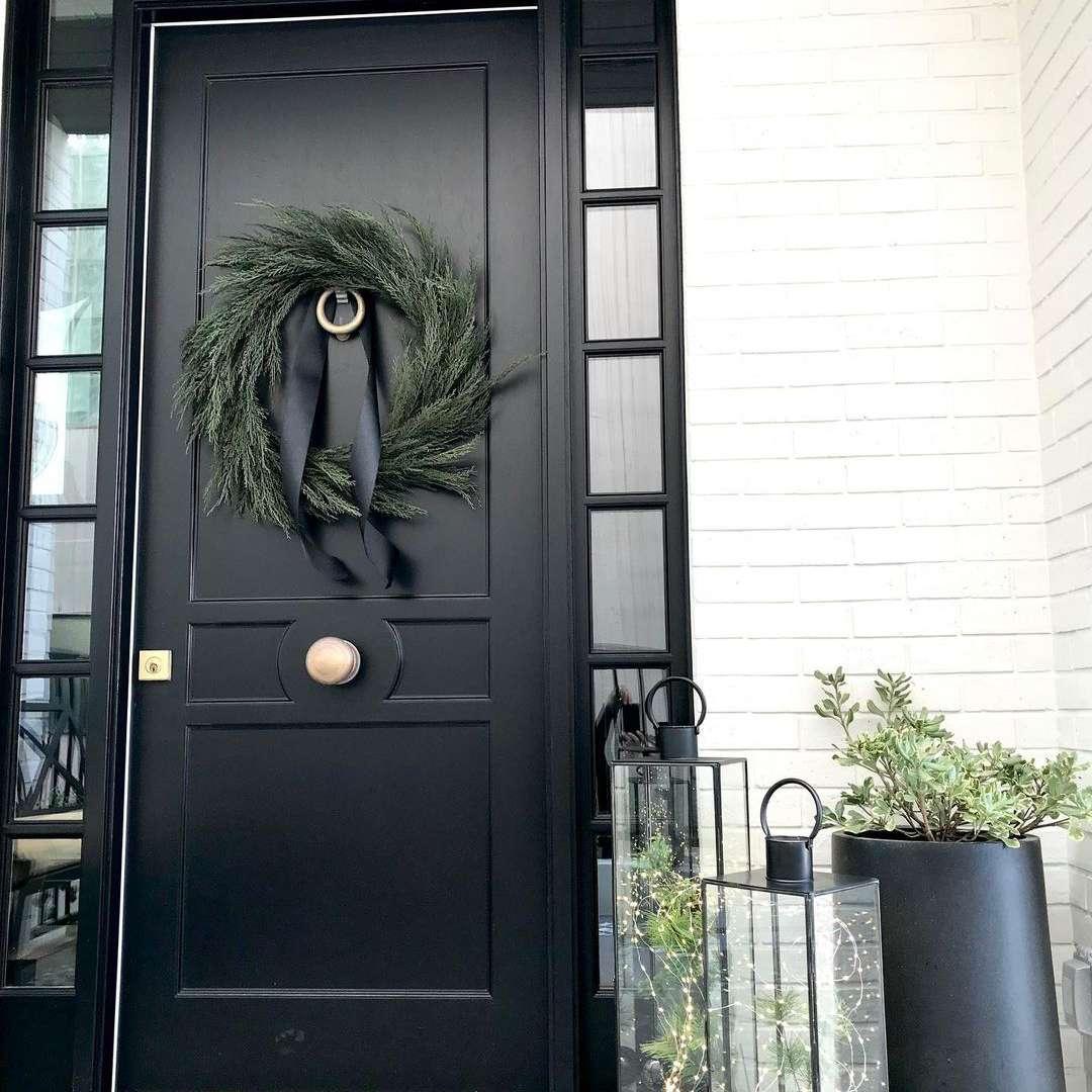 Black door with simple wreath