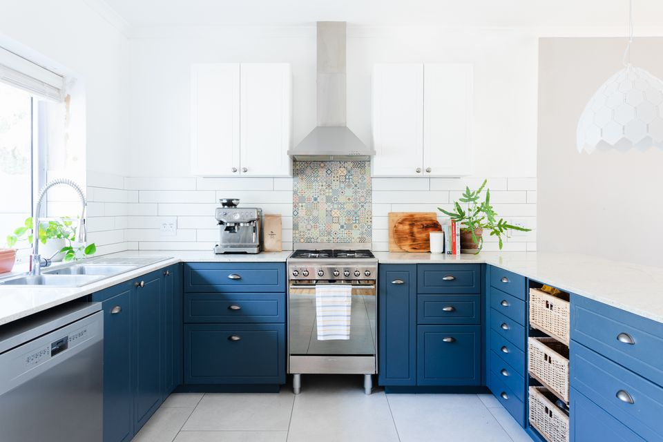 Large and brightly-lit kitchen with deep blue drawers