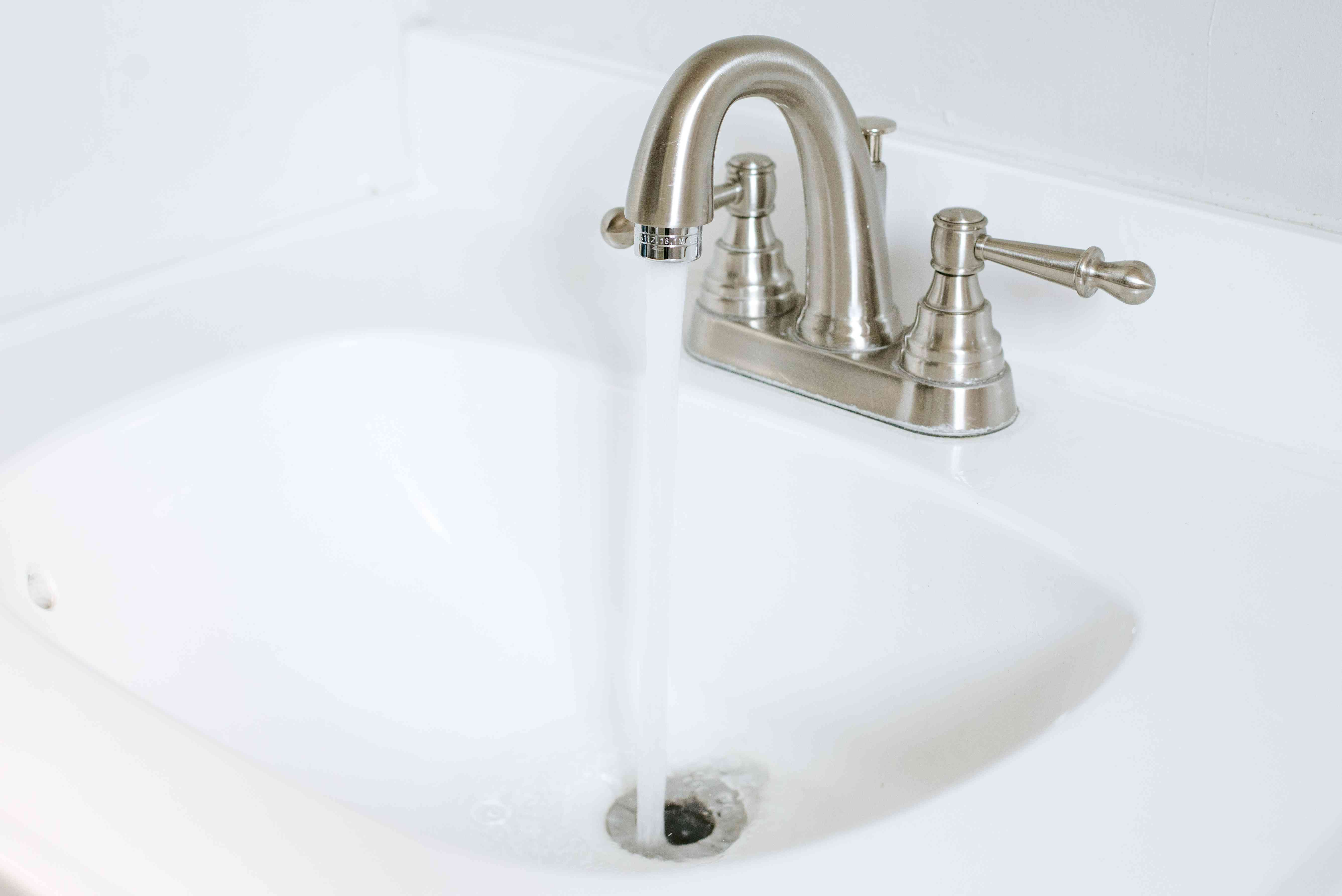 Faucet running hot water down sink drain to flush