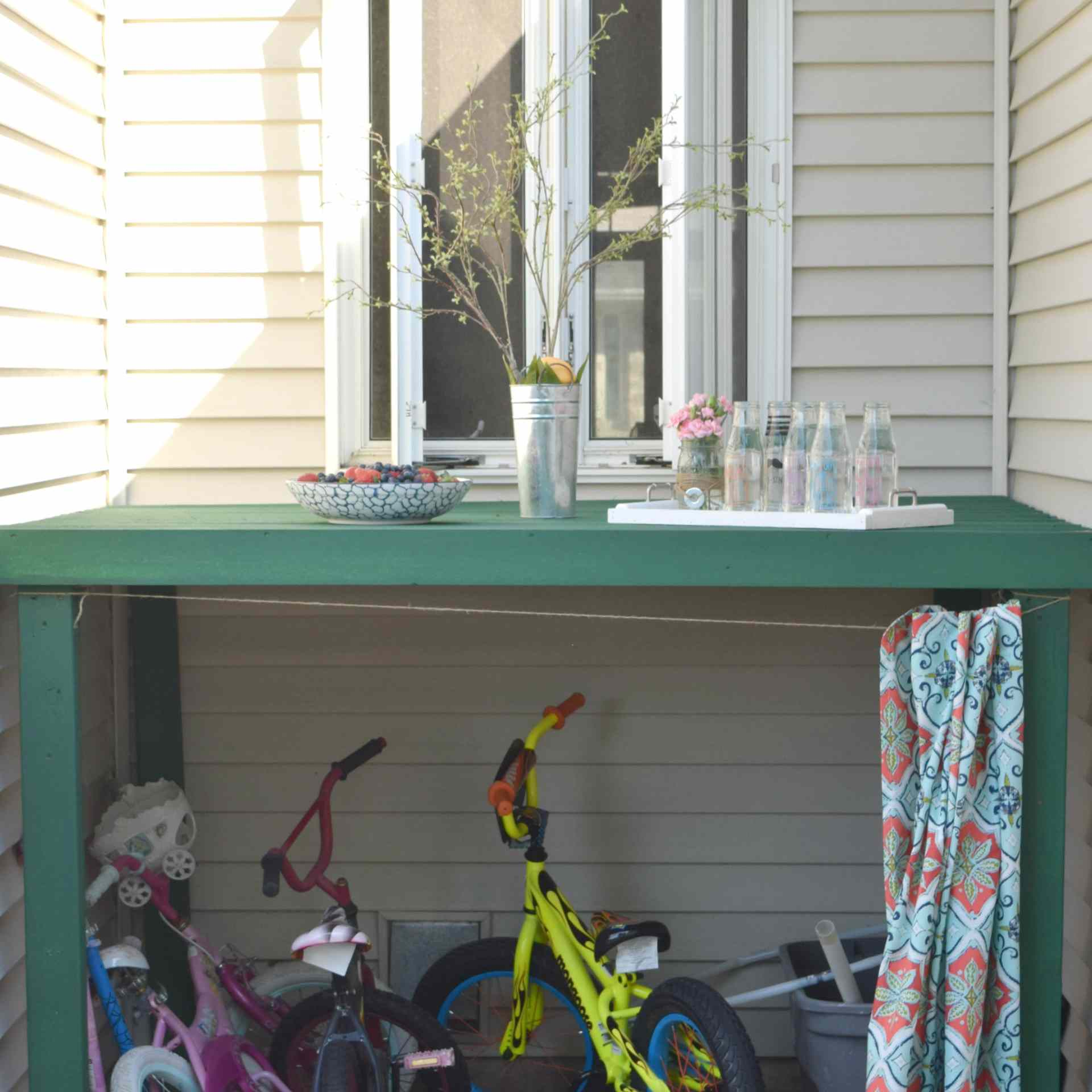 An outdoor table with bikes underneath