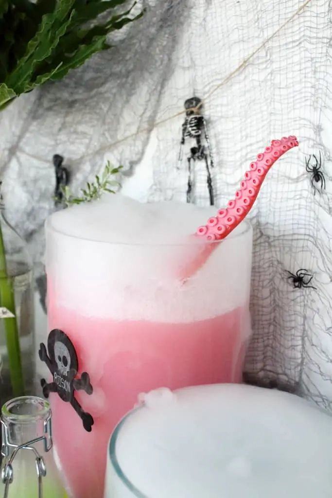 An octopus ladle in a pitcher of punch