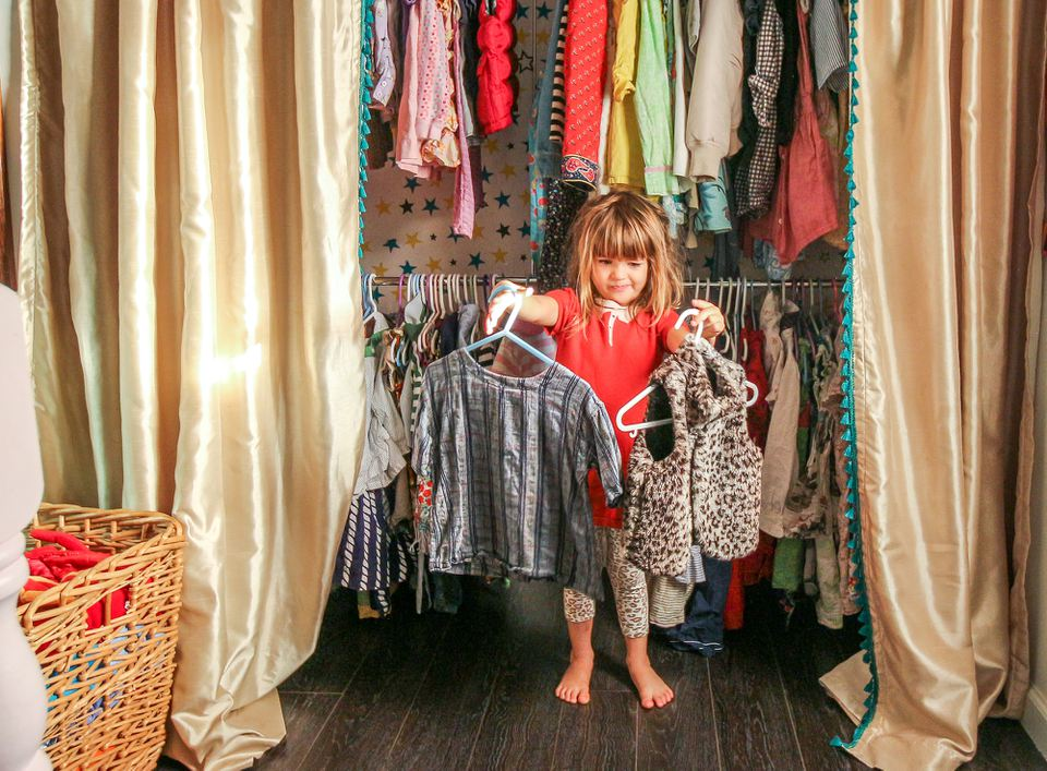 Kid in front of curtained closet