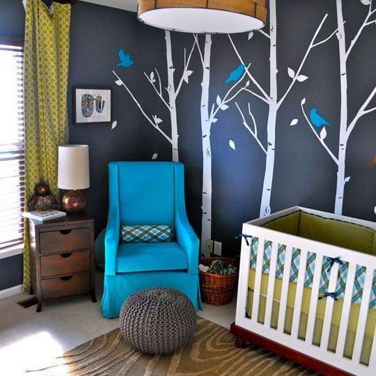 Black nursery with rich textures and blue and green accent