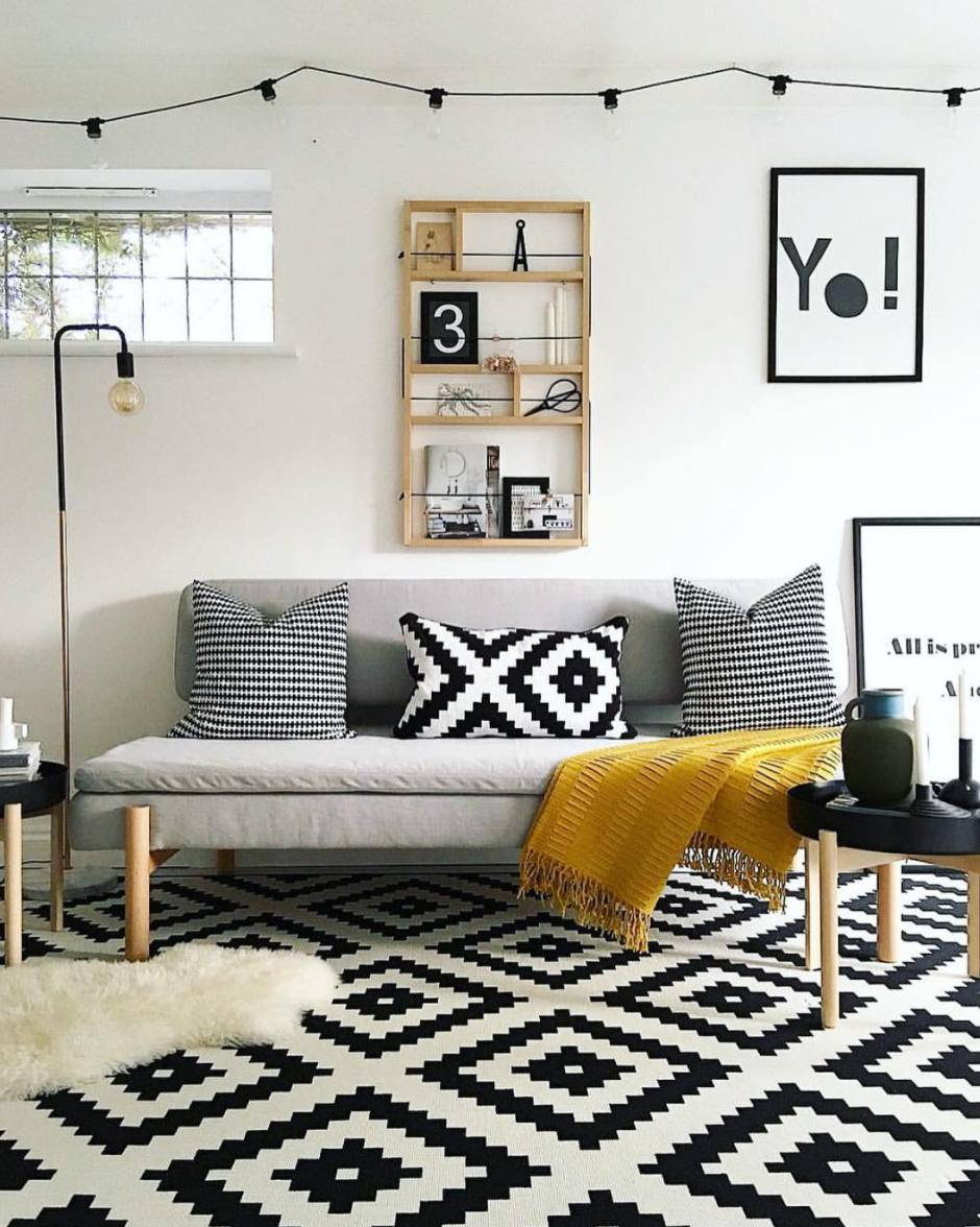 living room with mustard yellow and black and white