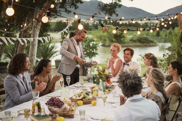 Man pouring champagne at wedding reception