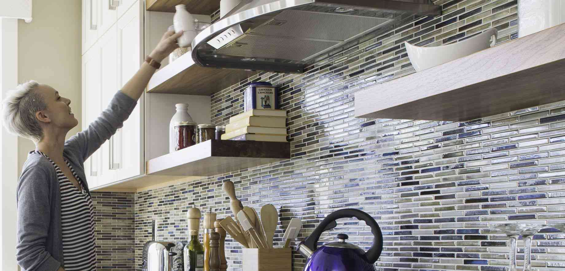 Kitchen with open shelving and mosaic tile