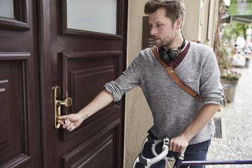 man unlocking door