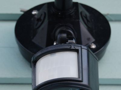 A motion detector used to control an outdoor, automatic light.