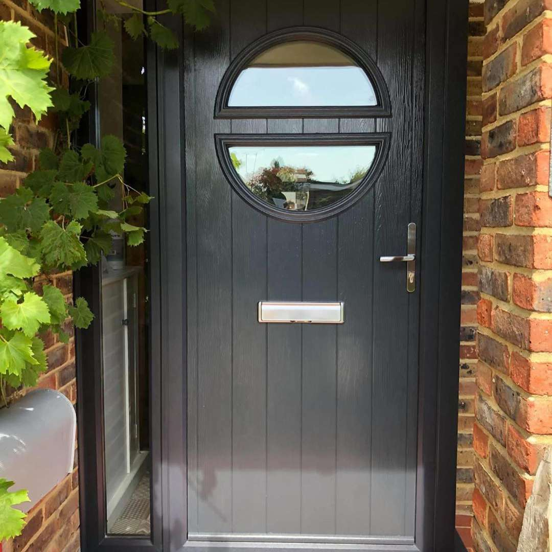 Black front door with semi circle glass