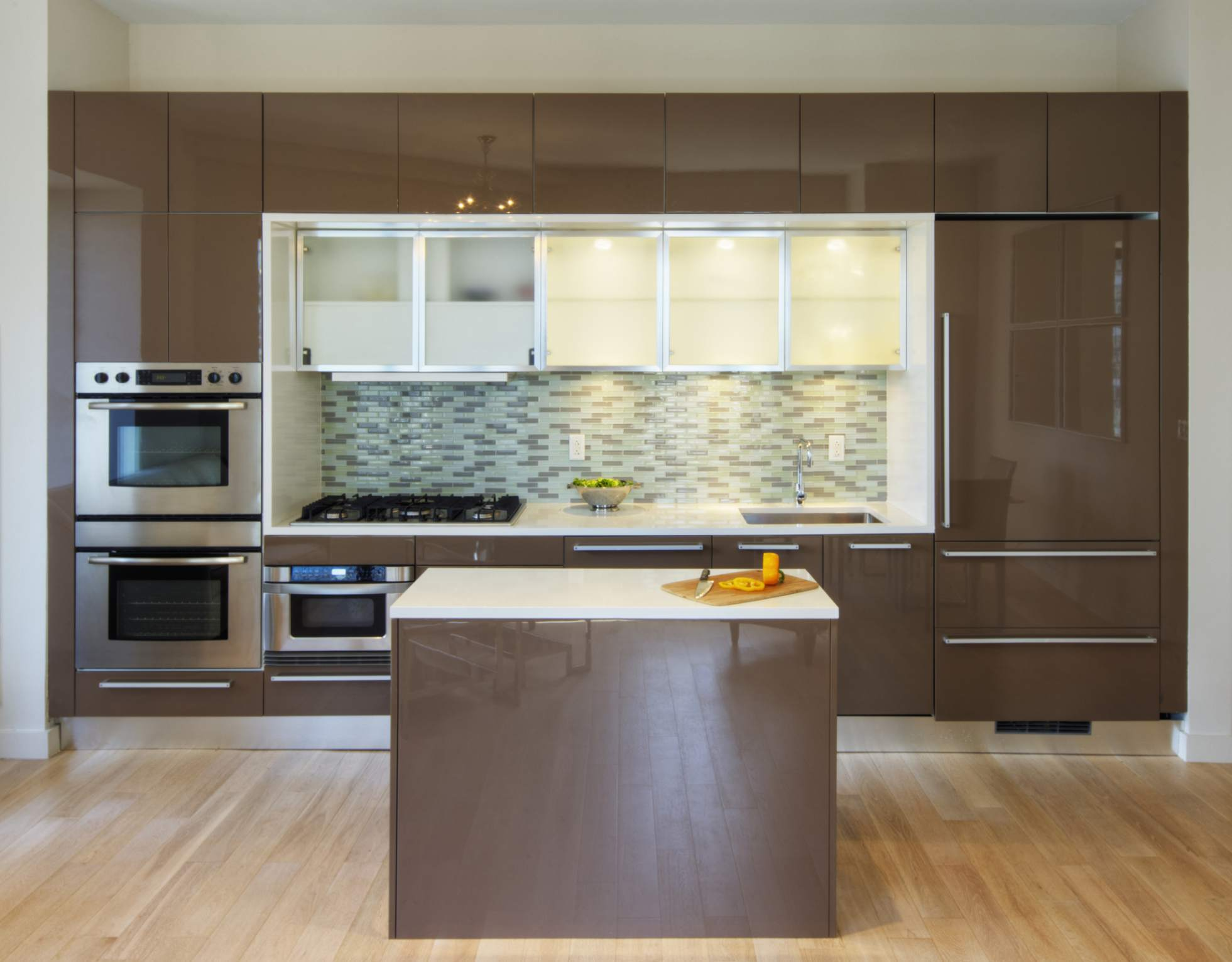 A set of high-gloss slab kitchen cabinet doors in a kitchen.
