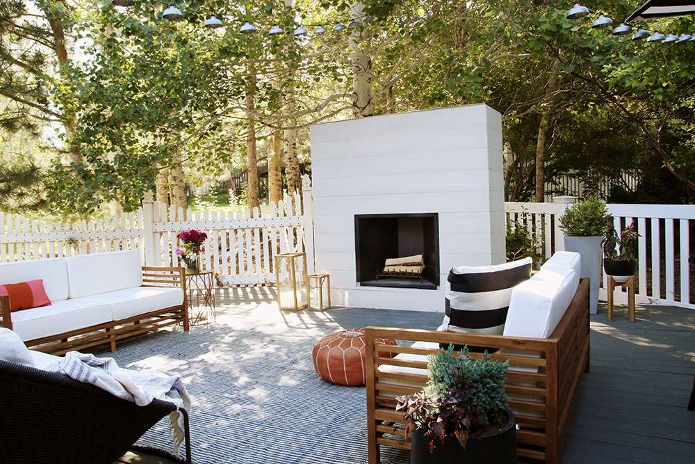 A white and black outdoor fireplace
