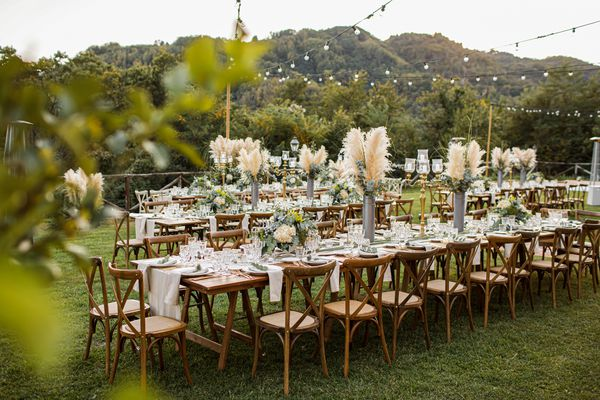 Wedding table set up in boho style with pampas grass and greenery