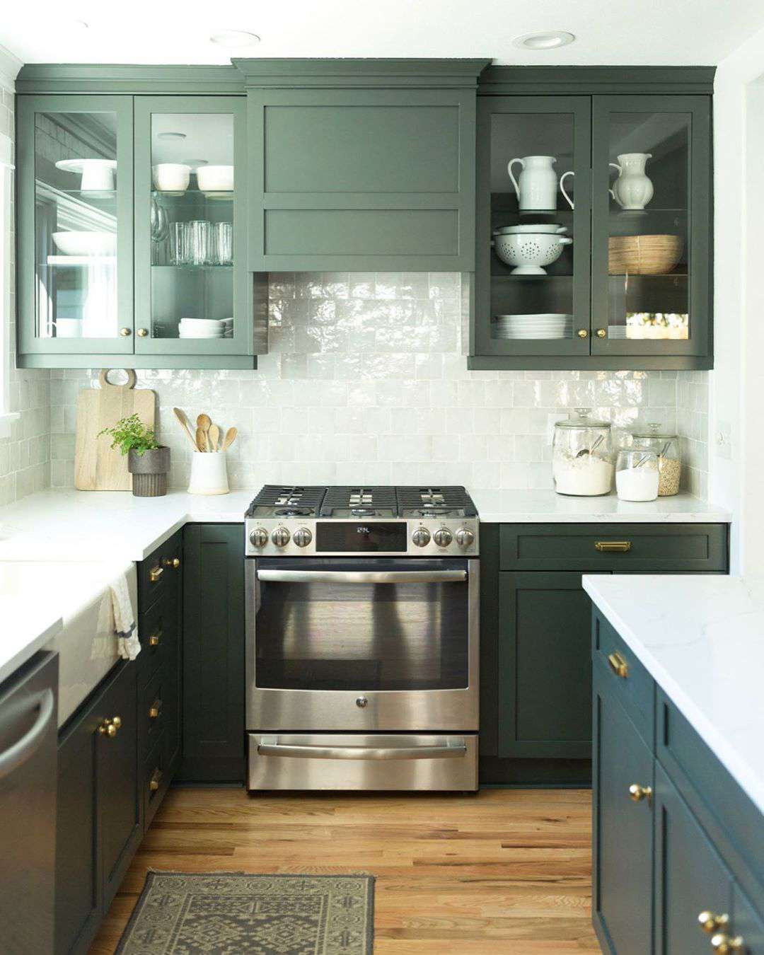 Green kitchen with clear glass cabinets