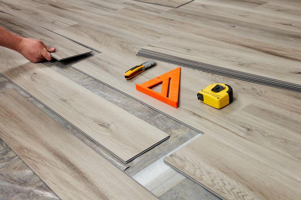 Floating floor wooden planks being installed