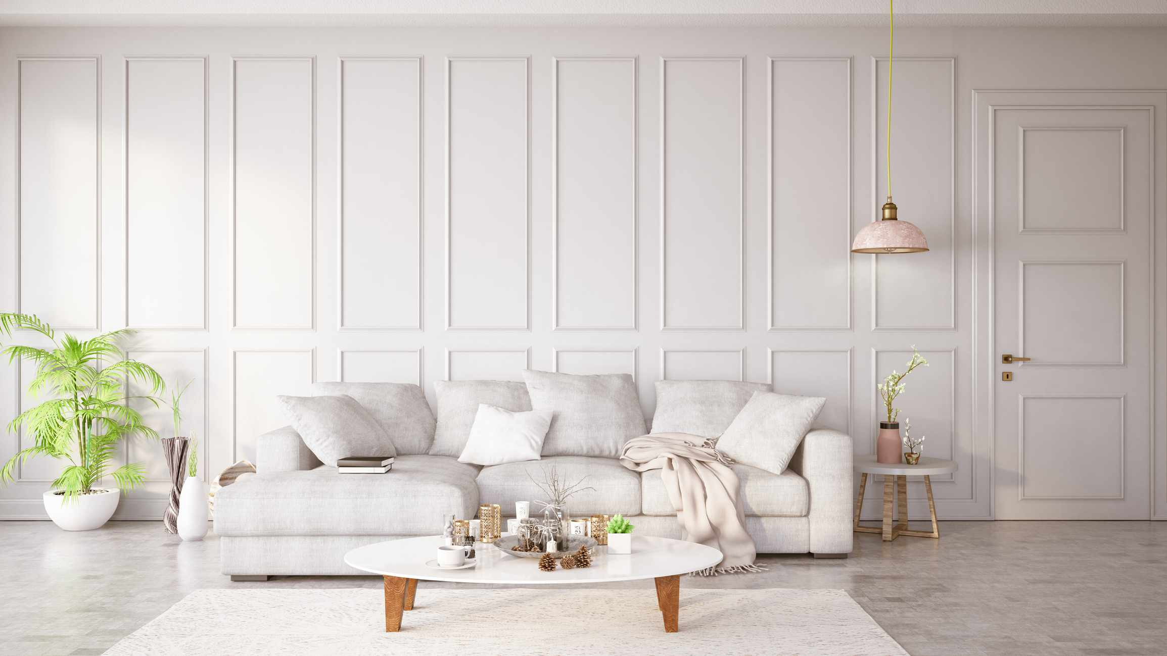 A white sofa in a white-washed space