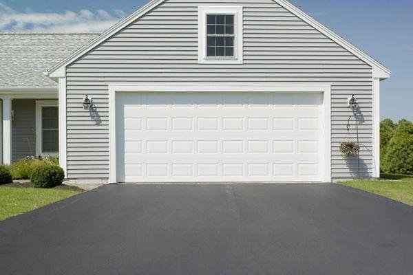 An asphalt driveway and a house's garage
