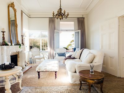 Traditional and elegant styled living room with neutral colors and architectural details