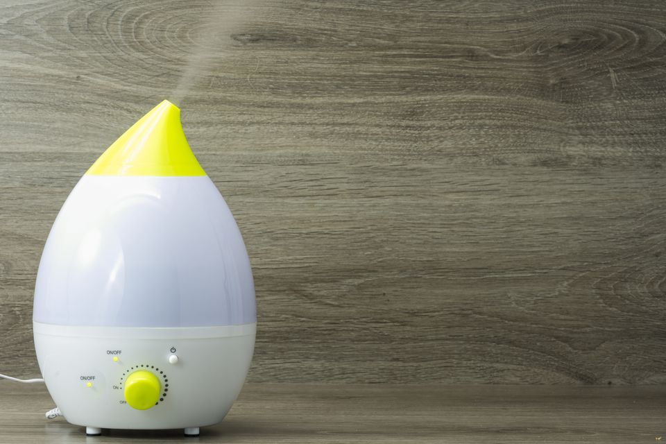 Ultrasonic humidifier against wood grain background