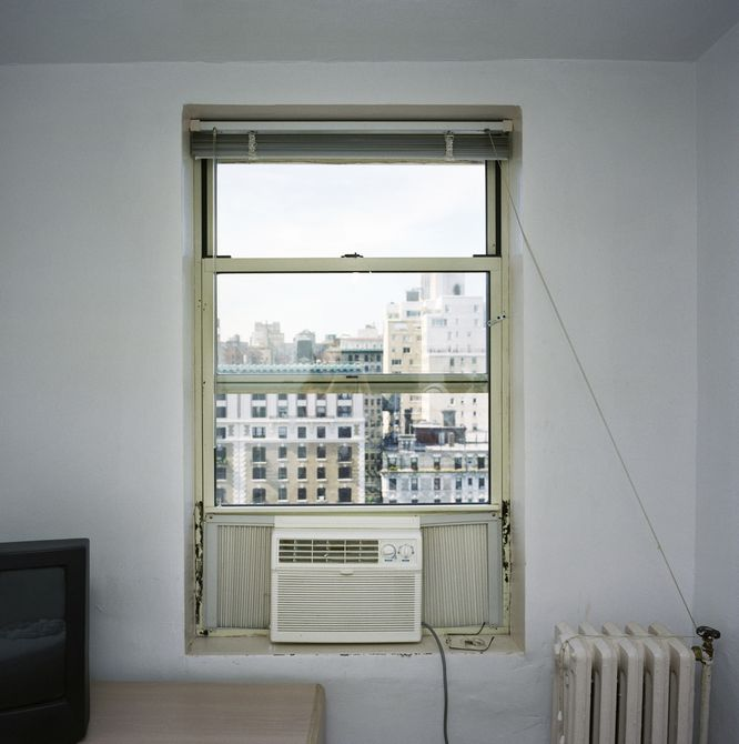 Air conditioner on a hotel window, Manhattan, New York City.