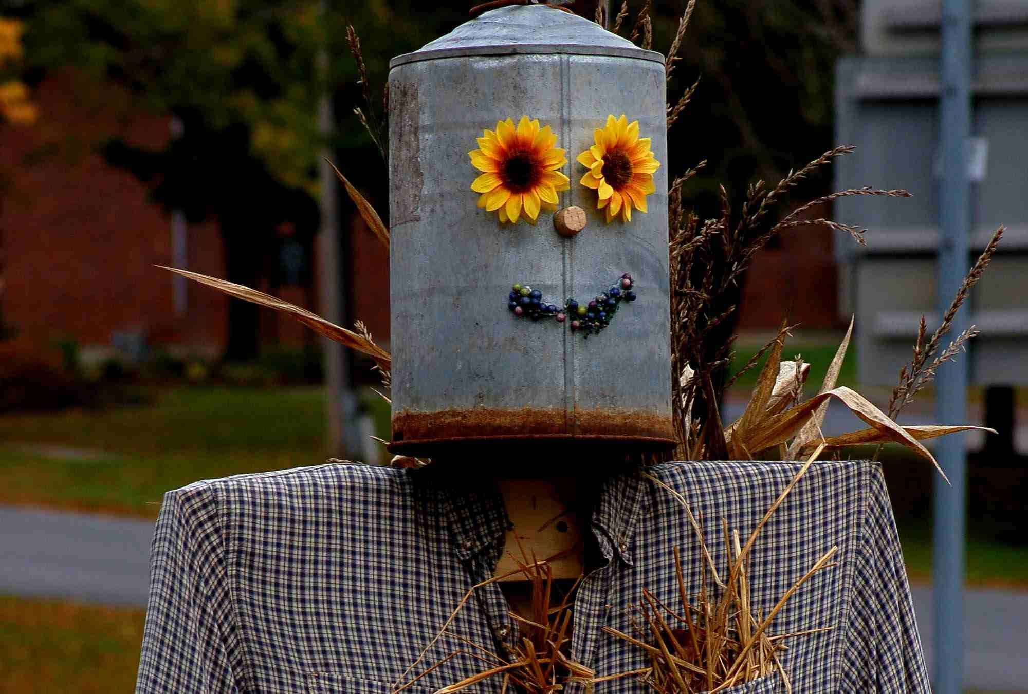 Scarecrow with a metal pot for a head
