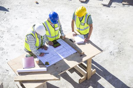 Construction Workers Planning A Design