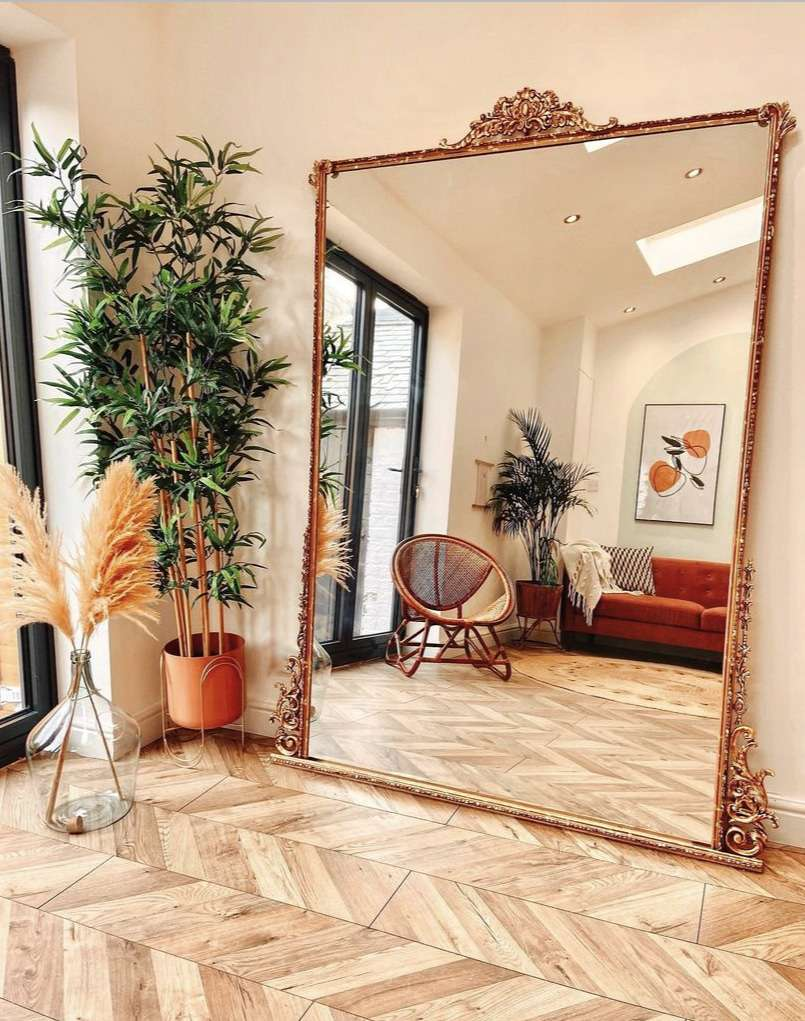 a large DIY mirror frame in antiqued gold